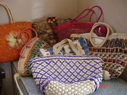 16. A kaleidoscope of meticulously hand weaved assorted bags.-