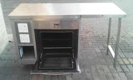 Commercial Oven and Stainless Steel Table.