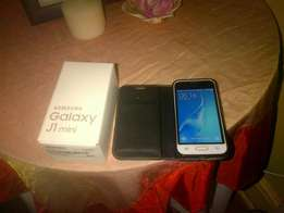 Samsung J1 mini with cover , charger and headfhones in Bloemfontein