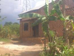 Unfinished house and land on sale