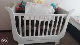 Wooden cot with matching rocking chair