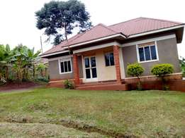 Land with house for sale in Bunamwaya, 35 decimals. 120M