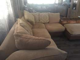 Stunning Corner Unit Couch with Ottoman in Beige and Brown.