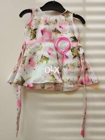 Baby girl dress (12 to 14 months).