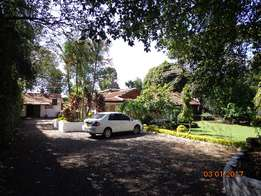 Elegant 5bedrooms plus 2br guest house, set on 1acre mature garden.