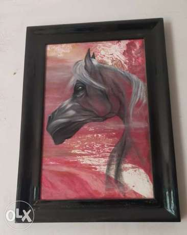 A painting, painted with oil, size 80 cm, with a wide black frame