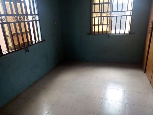 Clean renovated 2 bedroom flat all tiles floor at white house command Alimosho - image 5