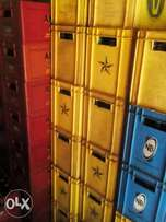 Empty crates of all kinds of drinks for sale at wholesale price.