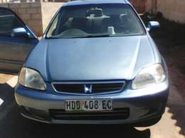 Selling Honda lux 99'' in good running condition papers in order