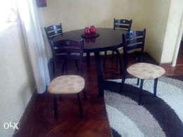 Gently used dinning table and chairs