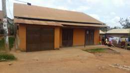 Shops with rental houses inside for sale on entebbe road at 90m