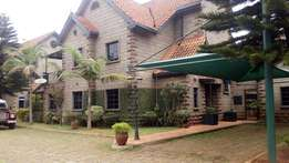 A 5 bedroom townhouse with a servant quarter for letting.