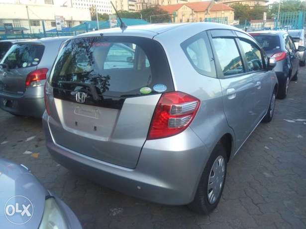 2011 model Honda Fit Silver, white n black all KCP number Mombasa Island - image 4