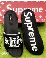Superior black supreme slippers