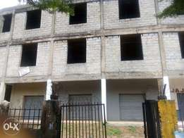 An Uncompleted 4 floors plaza which can be taking to 6 floors for sale