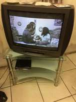Tube Tv for sell, with Tv stand and shelve for Books