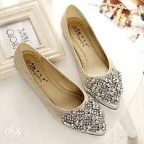 sophisticated studded flat shoe