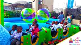 Bouncing Castles, inflatable pool, mini train and bumper cars for Hire