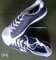 white and black colored sneaker