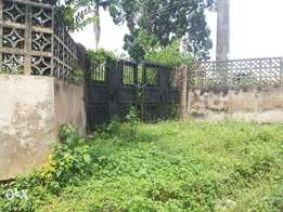 1 acres of land with a duplex building & B/Q At Apata
