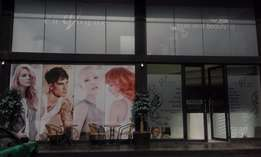 Chair rentals available for hairstylists in an upmarket salon.