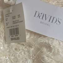 U.K. Never worn wedding gown at give away price