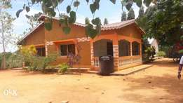 •Kilifi county mikingirini •Land of 2acreas and houses on sale •Two un