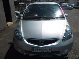 A Honda Jazz, 2006 model, silver in color, 4-door, with full service b