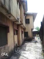 A storey building with 4 flats for sale in Alakuko for only N14m CofO