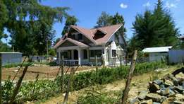 3 bedroom house at kapseret with title 500meters from tarmac