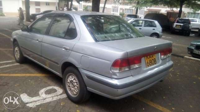 Selling Above Nissan Sunny B15, KAX 680B,Silver in Colour,Very Clean Langata - image 3