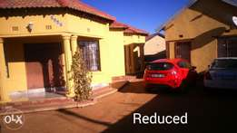 Three bedroom house and cottage for sale