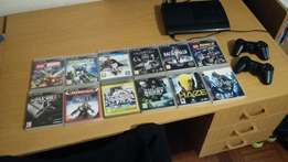 Playstation 3 Slim and 12 games