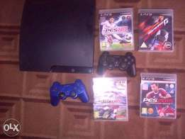 Play Station 3 with Accessories and 4 games