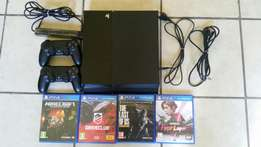 Ps4 500gb 2 controllers camera and 4 games