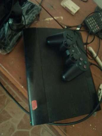 Super slim ps 3 with two pads and games Umoja - image 1
