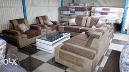 Get a free Glass coffee table when u buy this Sofas on sale