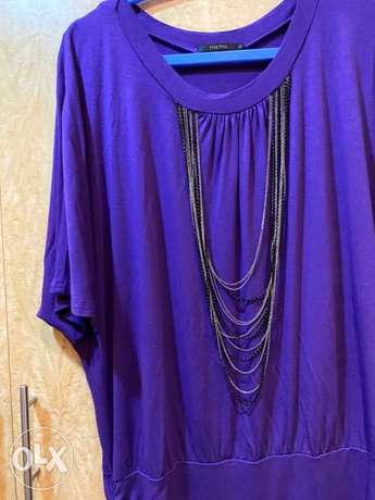 Beautiful purple top with attached chains
