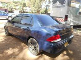 Local Mitsubishi Lancer, auto, year 2004. Asian owner selling.