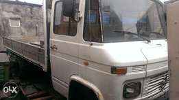 Tokunbo 608 Mercedes Benz truck with half sided body