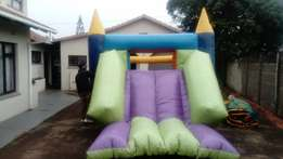 FOR SALE jumping castle with slide, including blower.