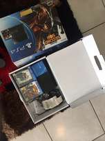 Sony PlayStation 4 with controller and 2 games