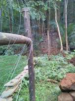 Electric fence installer and razor wire