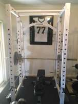 Commercial Squat Cage and assorted Gym Equipment