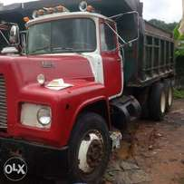 Red and white R model Mack tipper