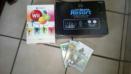 Wii with 3 games and sport box with tennis racket, golf, gun,,snooker