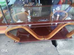 Glass table with mahogany wood