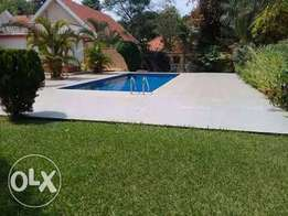Ggaba road storeyed mansion with swimming pool for sale