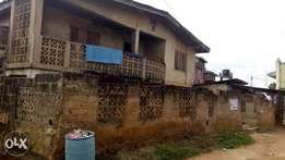 A tenement building of 16 rooms and a bq at Eleyele Ibadan
