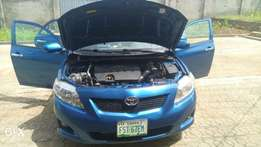 An Ultra Clean 2009 Toyota Corolla LE Sedan for sale with low millage